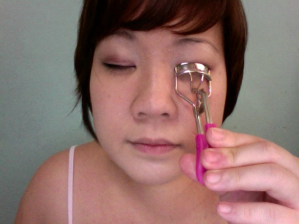 Step 10 - Crimp your lashes. Bounce the eyelash curler a few times, jiggle it lightly.