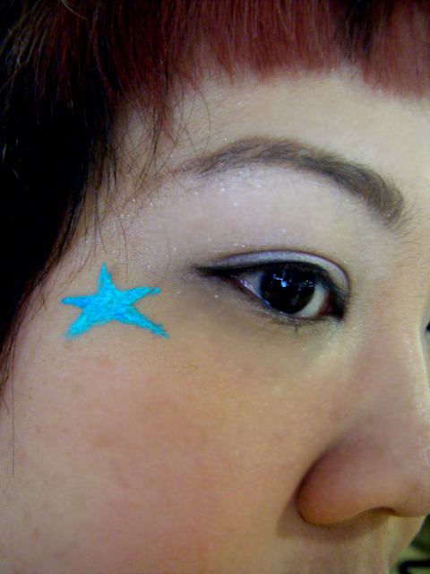 Star drawn with MAC Liquidlast Liner in Aqualine