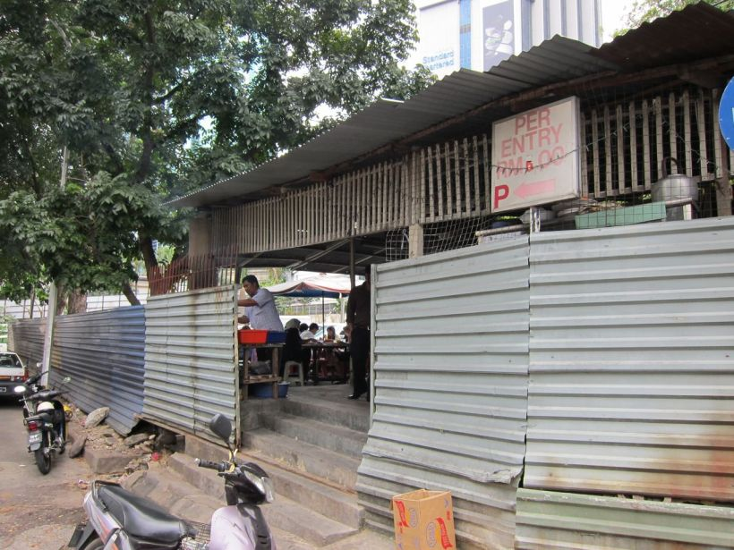 My last meal in KL was in a non-descript zinc & wood shack in the middle of a carpark.