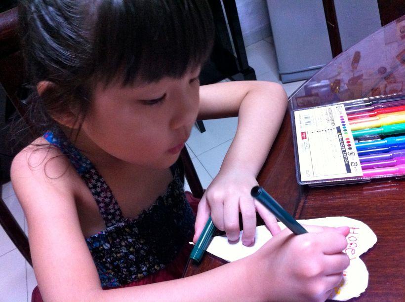 Making a card for her friend Trisha