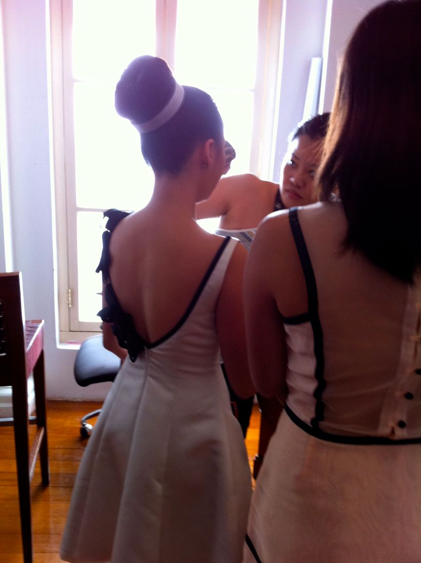 The back of her dress... Final touches to her make-up