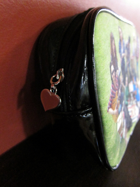 Patent leather lining and a heart-shaped zipper pull!
