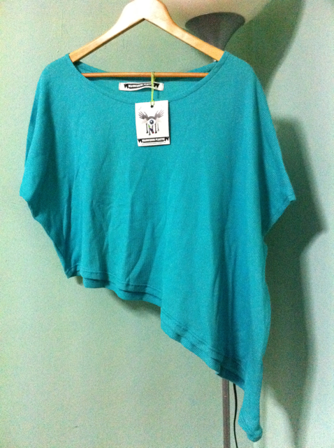 Teal asymmetrical hem top from Mannequin Plastic