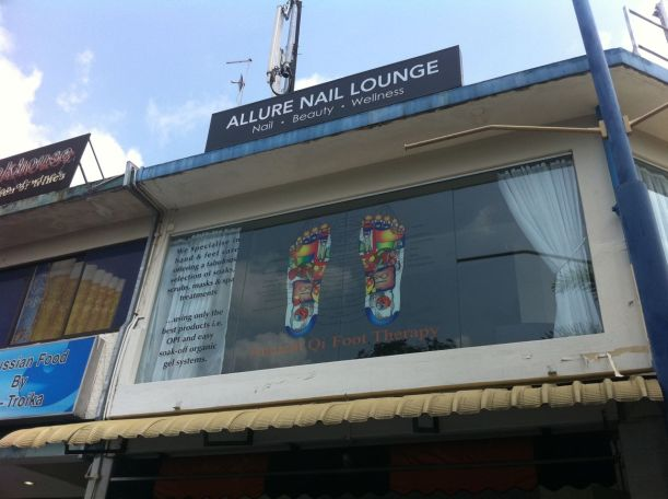 Allure Nail Lounge shares a unit with a foot reflexology place