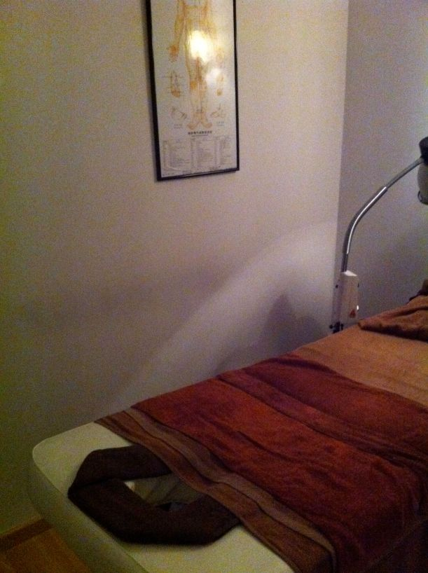 The room and the bed. Functional. And a Chinese acupoint chart.