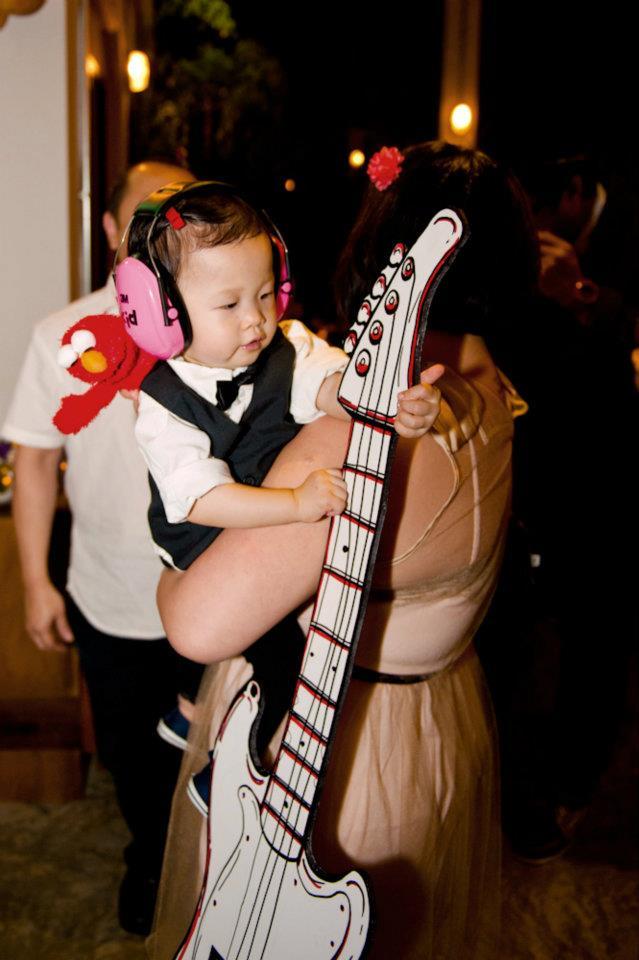 Kate rockin' her earmuffs and the cardboard guitar