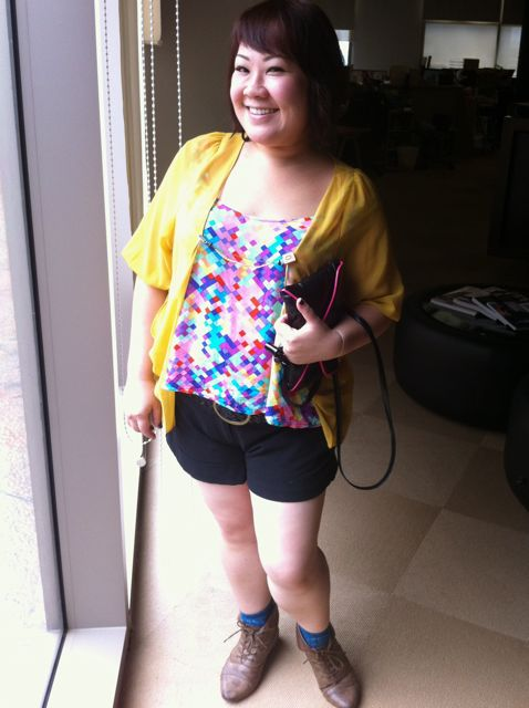 Mustard yellow chiffon jacket with shorts and a colourful tank top